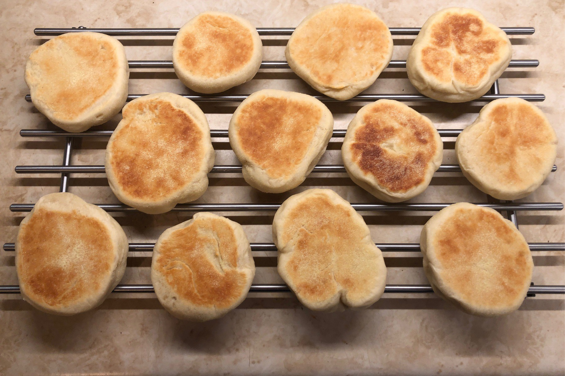 English muffins cooling on rack.