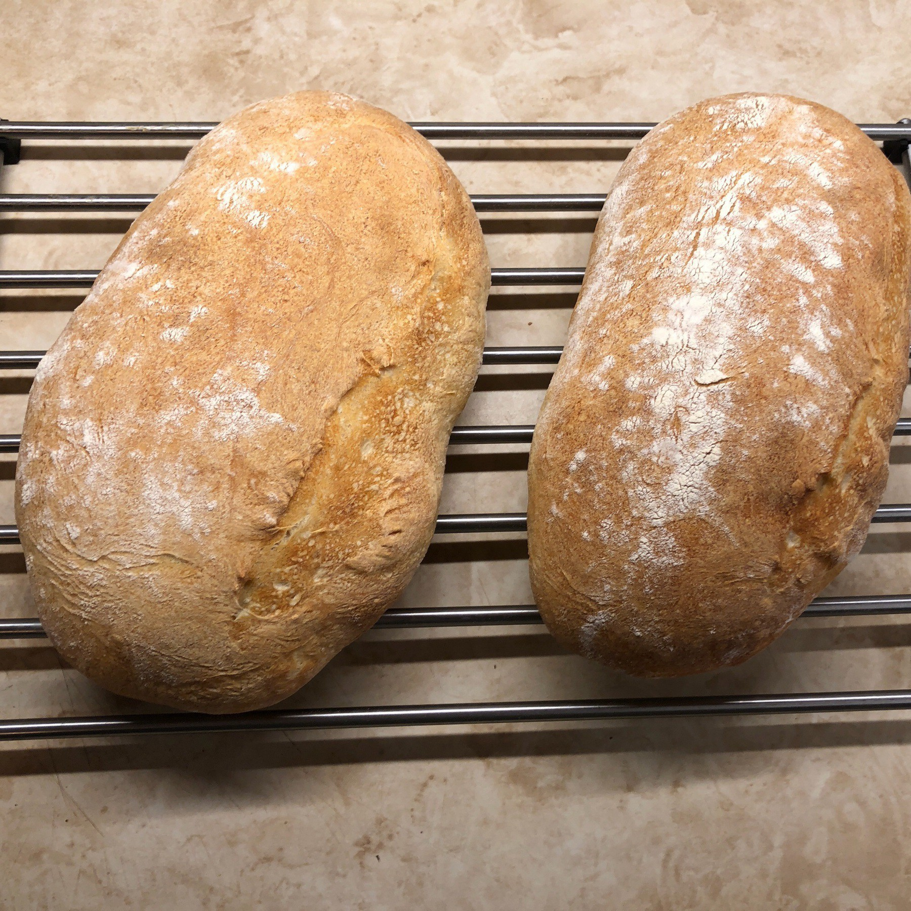 Loaves of bread on a cooling rack.