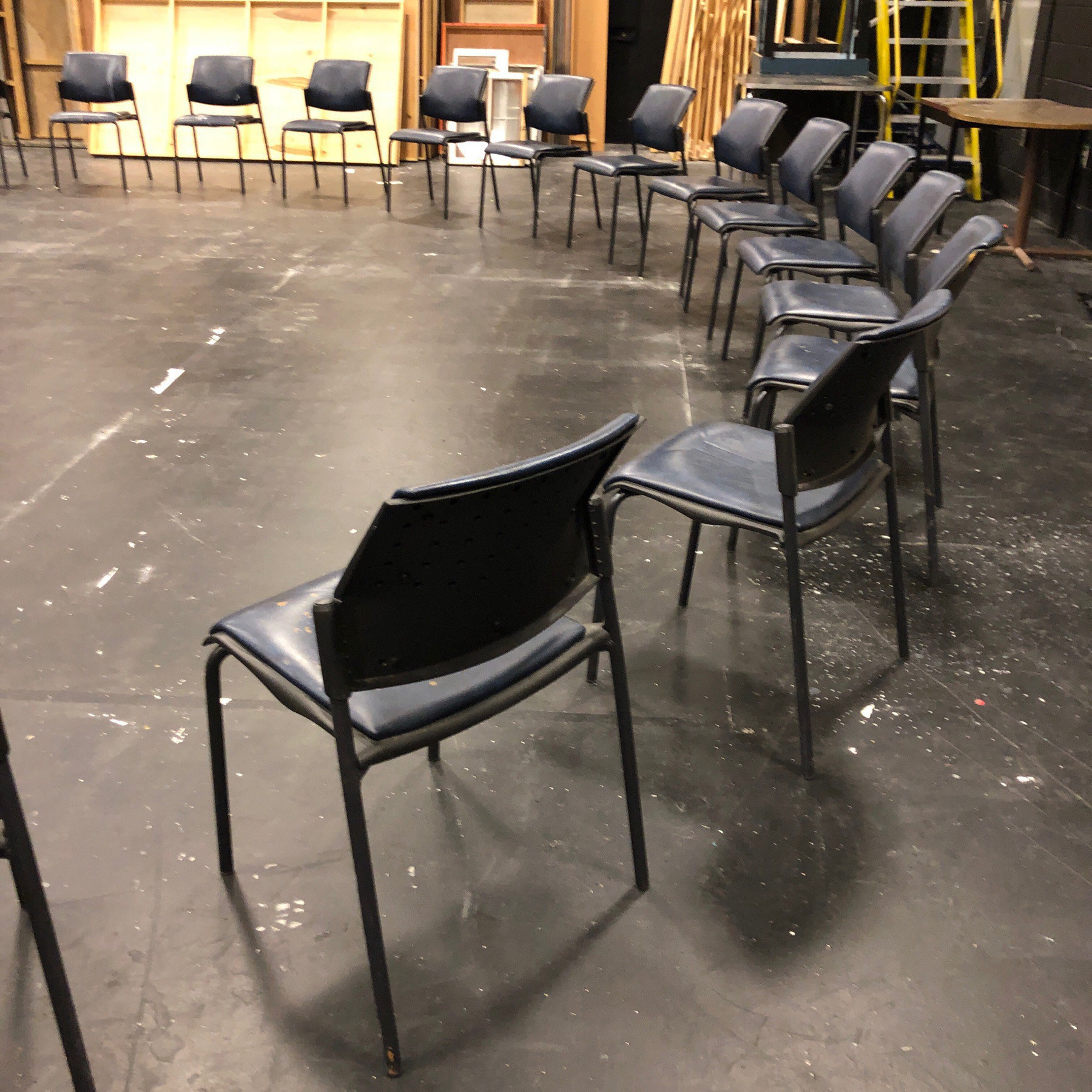 Chairs is semicircle in film studio.