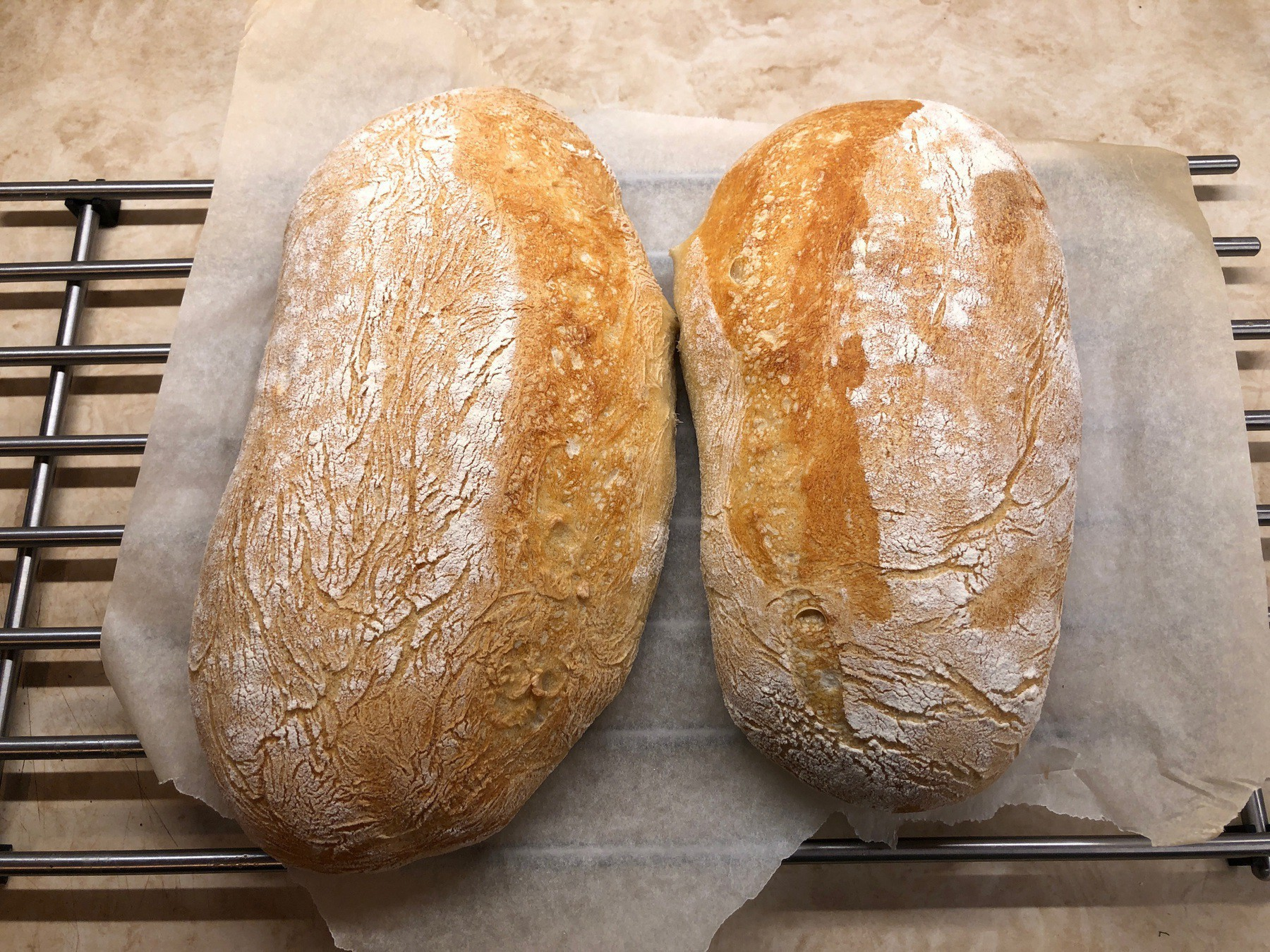 Two loaves of bread cooling.