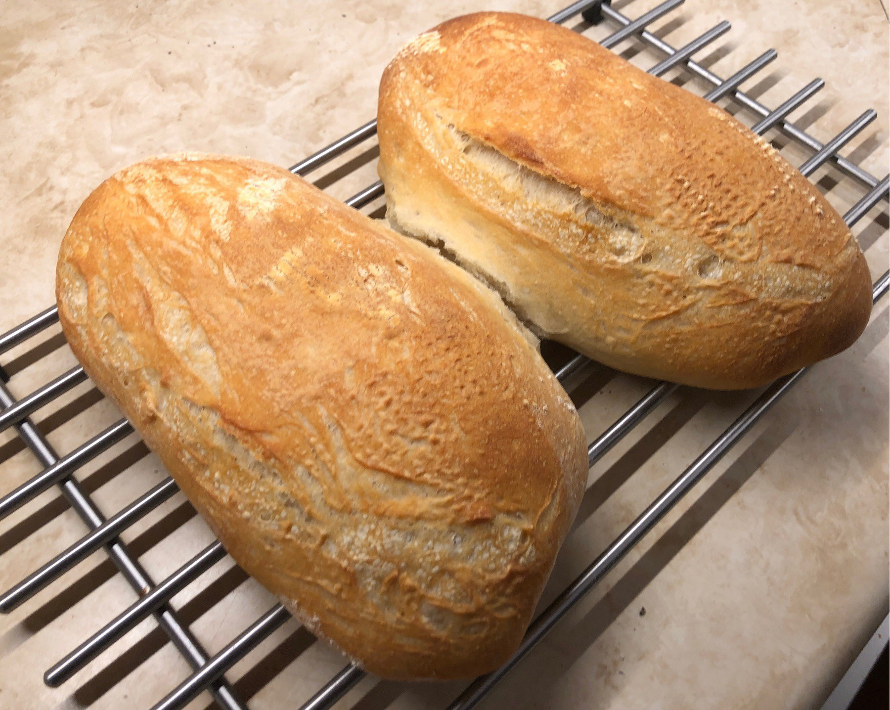 Loaves of sourdough bread cooling.