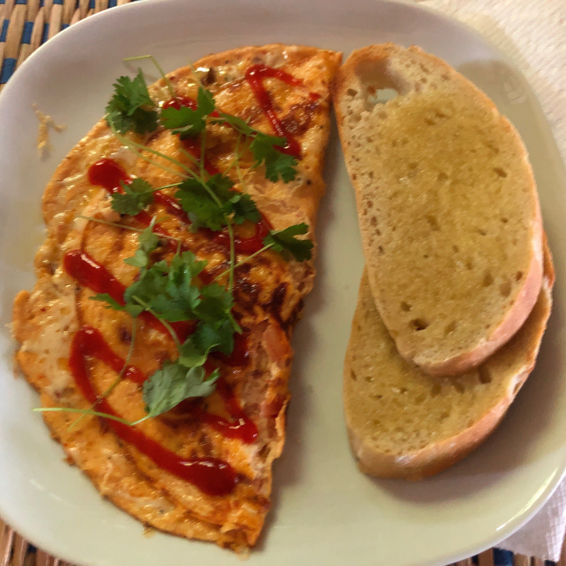 Omlette and toast on plate.