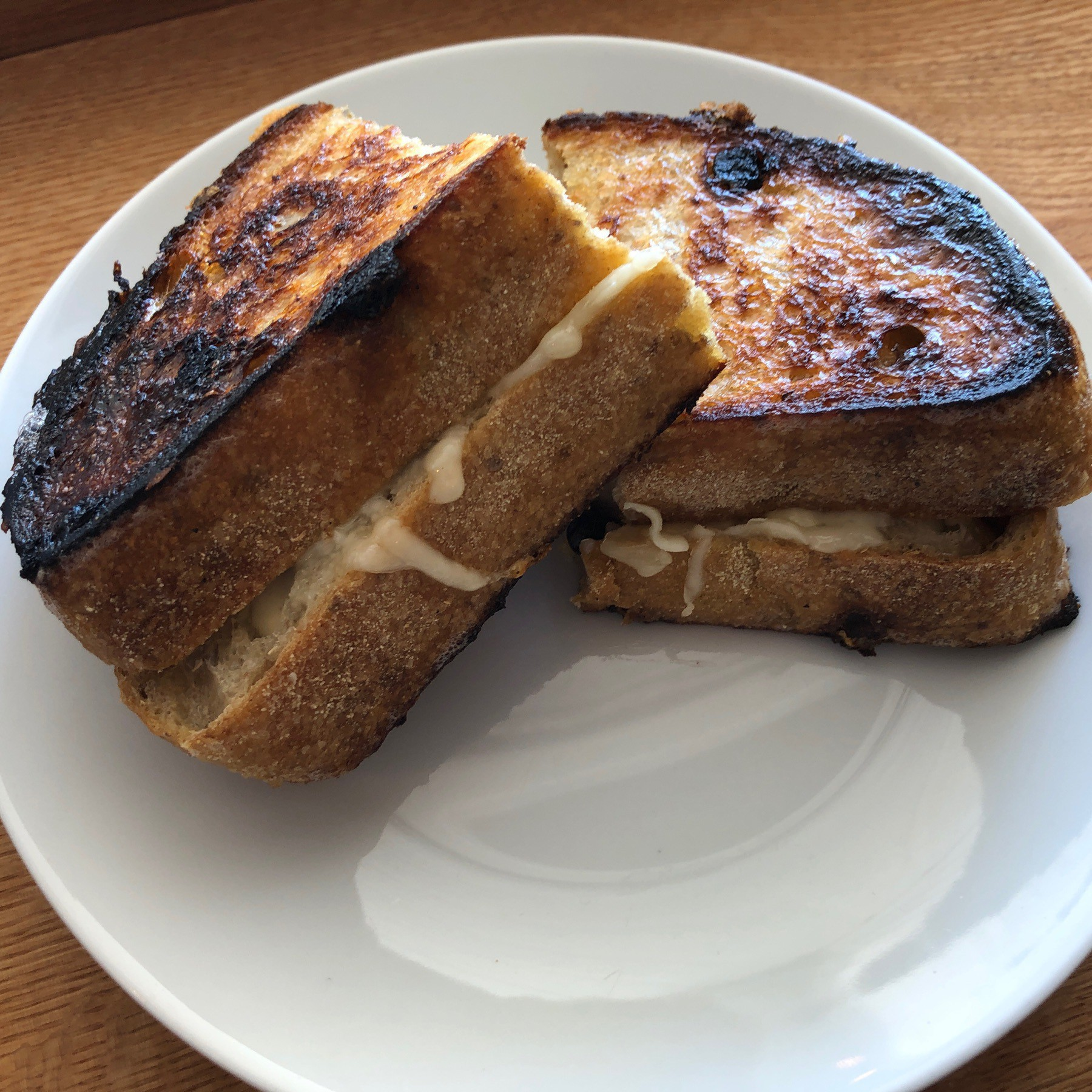Grilled cheese sandwich on plate.