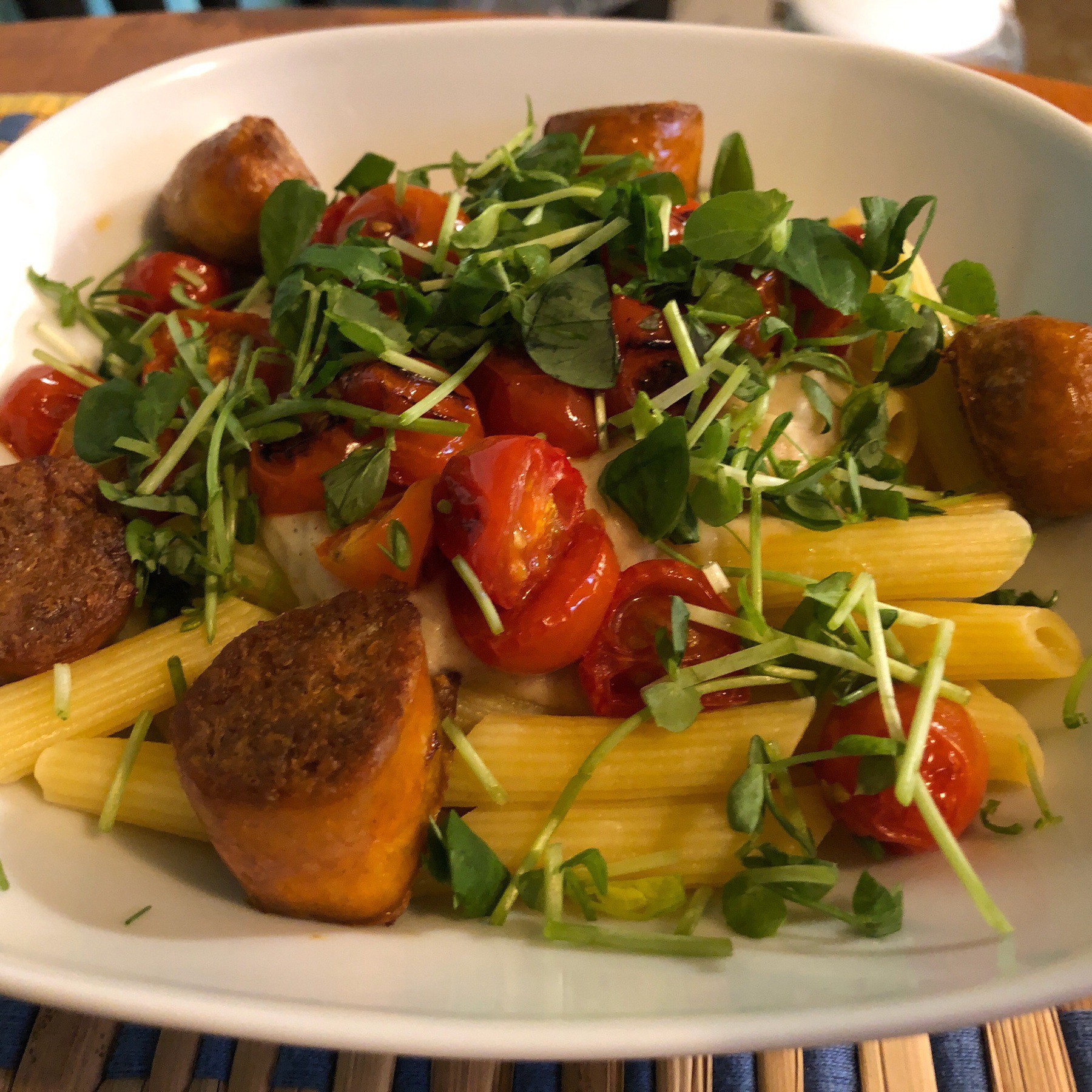 Pasta and veggie sausages in bowl.