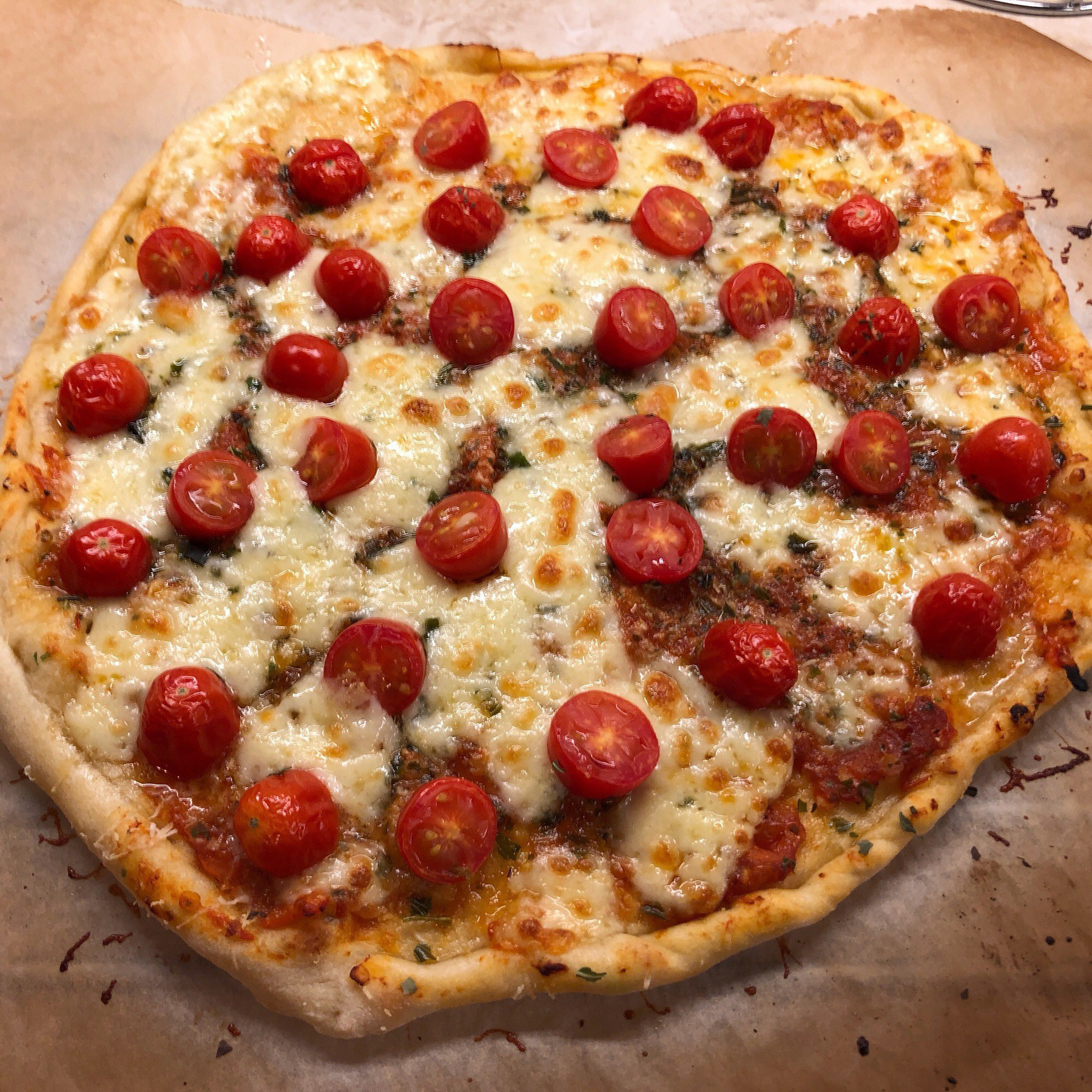 Pizza with small tomatoes on it