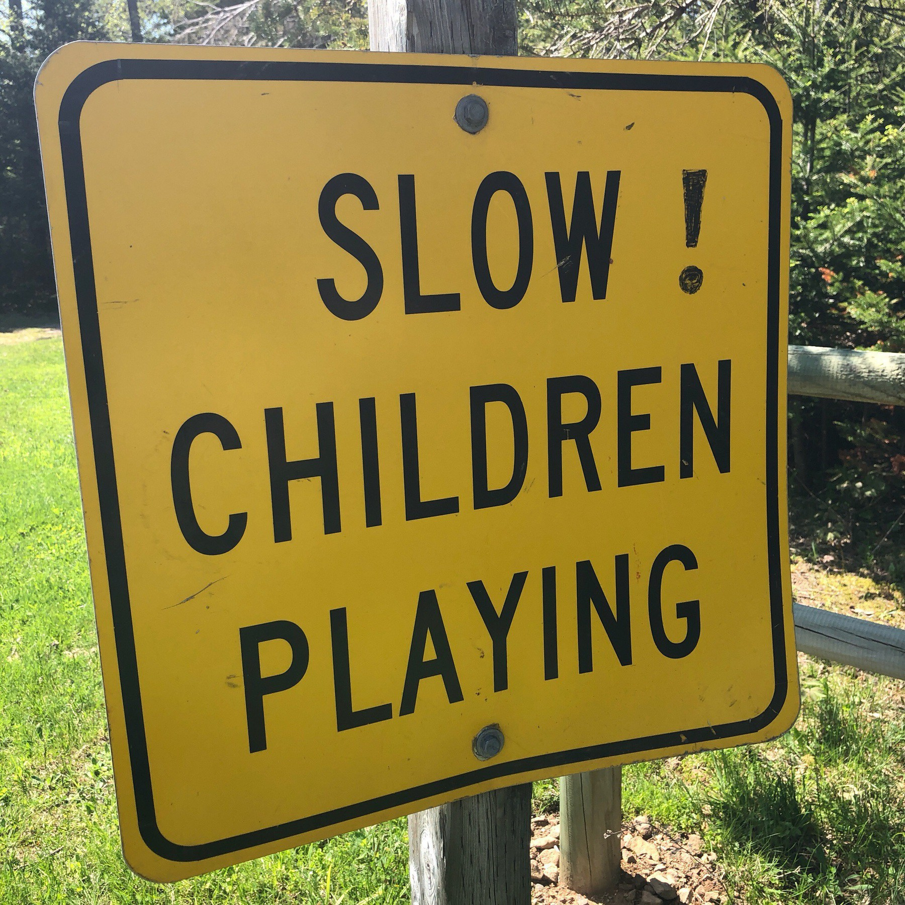 "Sign saying ""Slow! Children playing."""