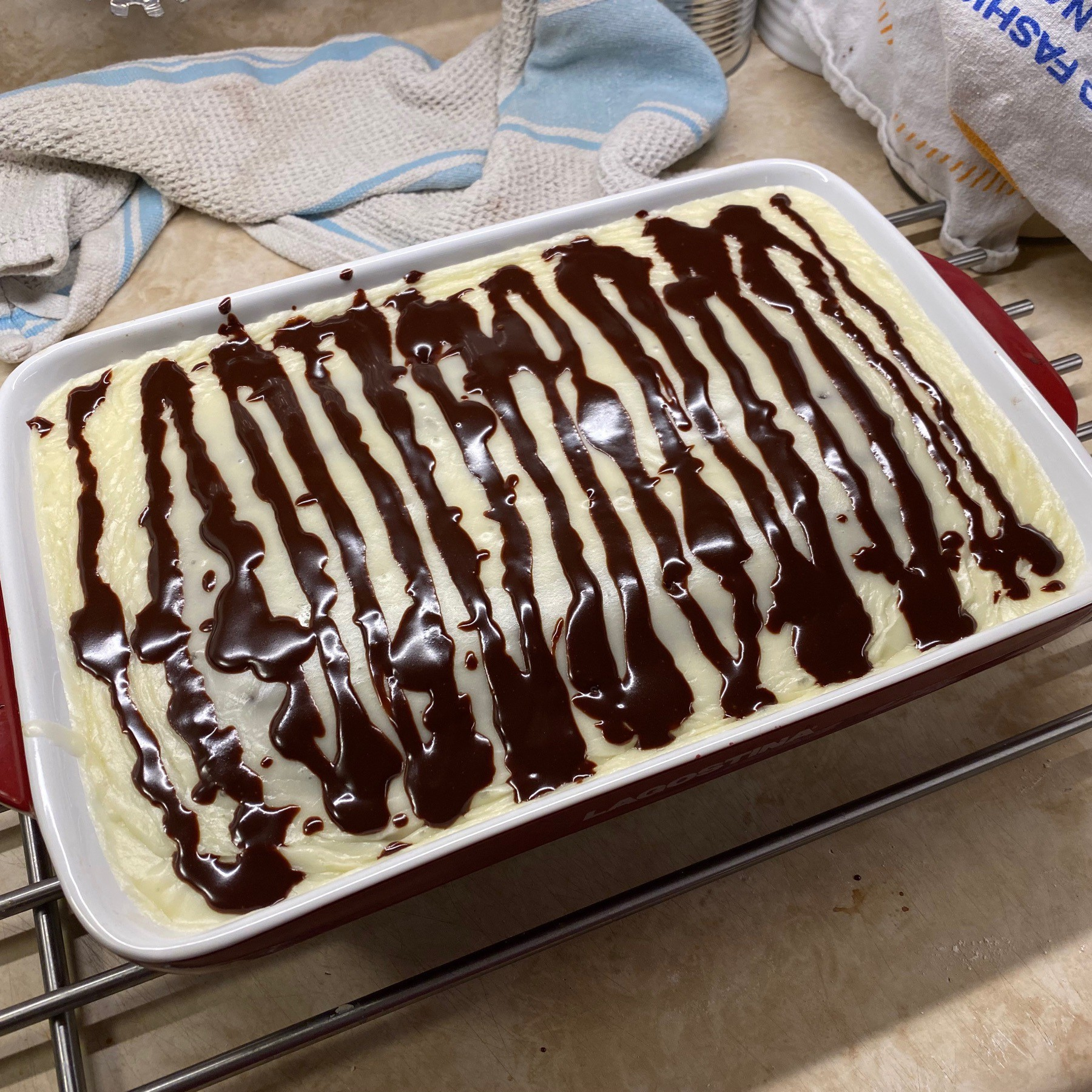 Chocolate cake in pan with icing on top.