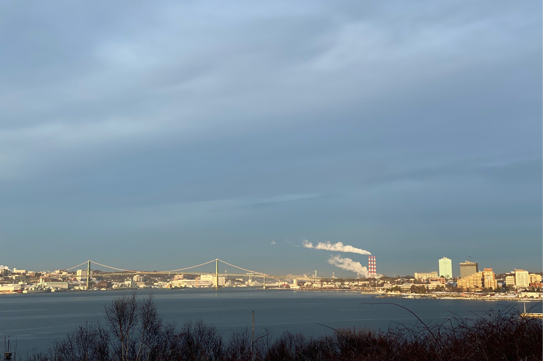Clouds in sky over bridge and harbour.