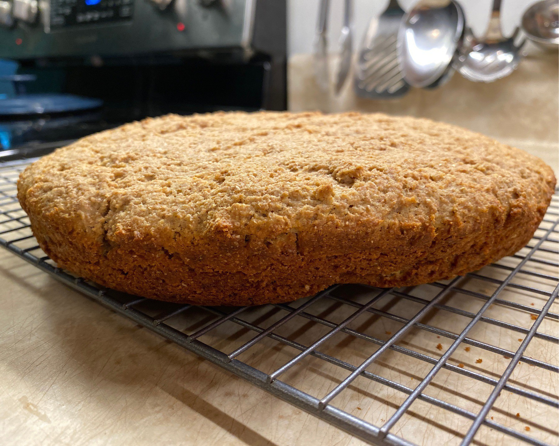Brown bread cooling on rack.