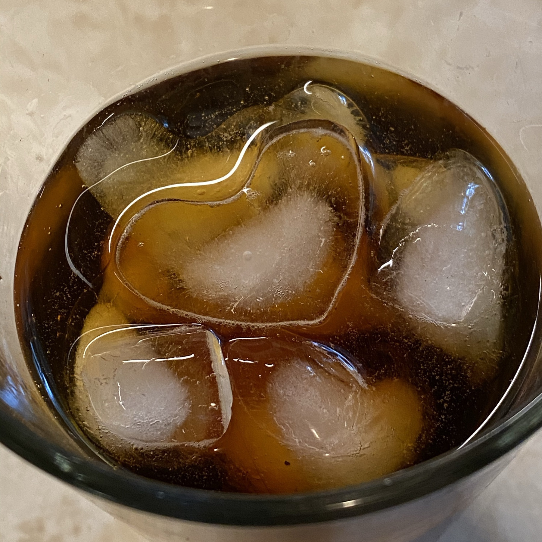 Cold brewed coffee in glass with ice cubes.