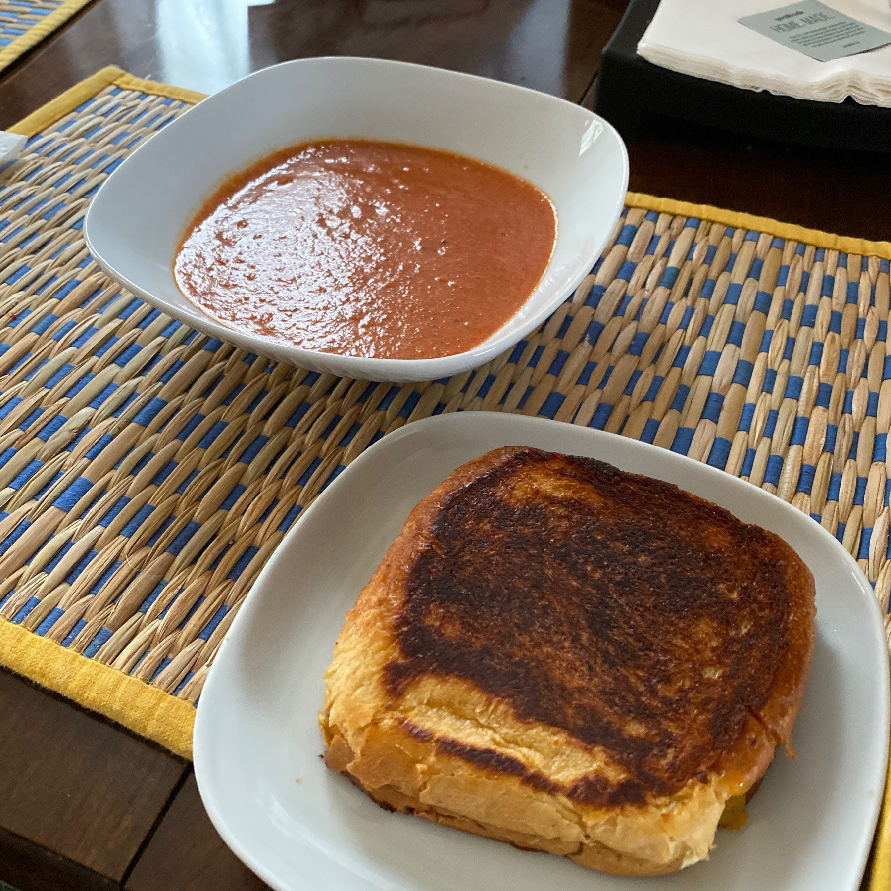 Grilled cheese sandwich and bowl of tomato soup.
