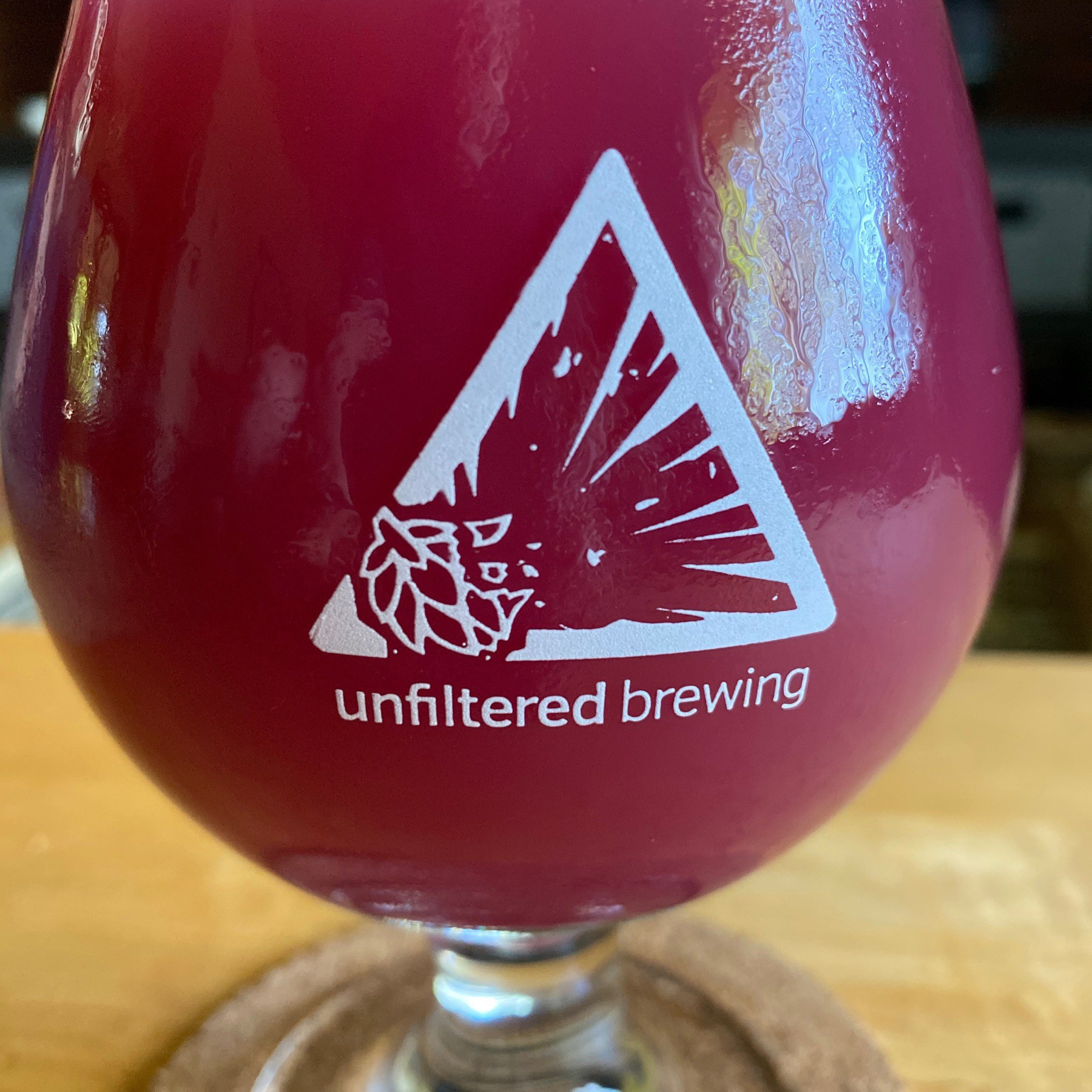 Blueberry beer in glass.